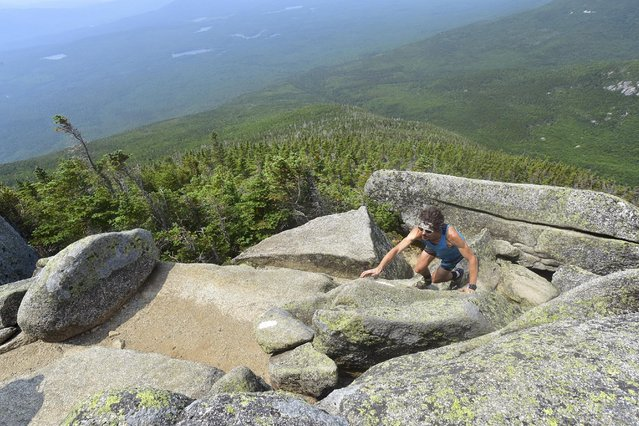 Scott Jurek, who claimed the title of quickest trek of the 2,180-mile (3,508-km) Appalachian trail from Georgia to Maine, is shown during his hike in this photo released to Reuters on July 14, 2015. It required running at night on rock-strewn slopes, then sleeping as little as an hour before resuming the daily pace of 47 miles (76 km) that would shatter the record for the fastest-ever completion of the Appalachian Trail. (Photo by Luis Escobar/Reuters)