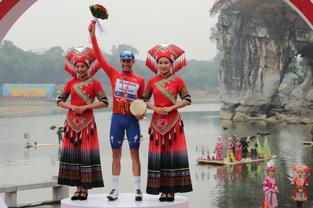 Enric Mas of Spain celebrates on the podium after winning the Tour of Guangxi cycling race in Guilin, in China's southern Guangxi region on October 22, 2019. (Photo by AFP Photo/Stringer)