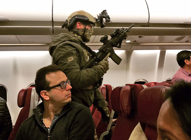 Police in tactical gear board a Malaysia Airlines plane after a man tried to enter its cockpit in Melbourne, Australia, Thursday, June 1, 2017. The Malaysia Airlines plane returned to Australia after the man threatened to detonate a bomb and attempted to enter the cockpit before he was tackled and tied up by passengers, police said Thursday. The 25-year-old Sri Lankan man had been discharged from a Melbourne psychiatric hospital on Wednesday before buying a ticket on the late-night flight to Kuala Lumpur, Malaysia. (Photo by Andrew Leconcelli via AP Photo)