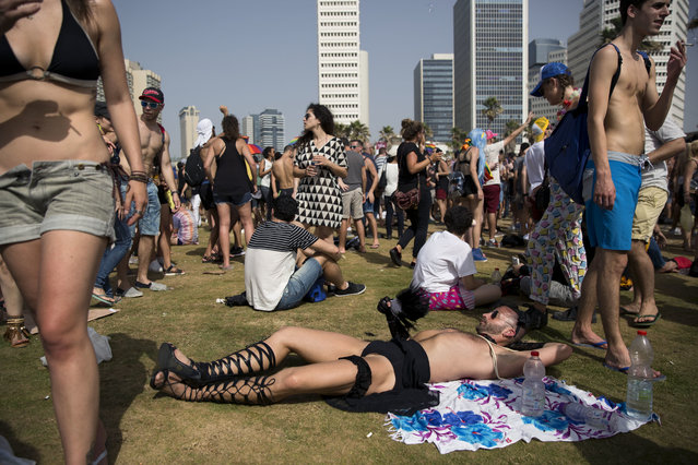 People participate in the annual Gay Pride Parade in Tel Aviv, Israel, Friday, June 3, 2016. (Photo by Oded Balilty/AP Photo)
