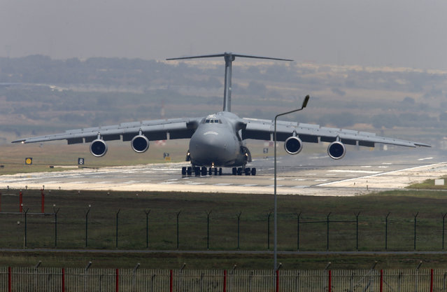 A United States Air Force cargo plane maneuvers on the runway after it landed at the Incirlik Air Base, in the outskirts of the city of Adana, southeastern Turkey, Wednesday, July 29, 2015. After months of reluctance, Turkish warplanes started striking militant targets in Syria last week, and also allowed the U.S. to launch its own strikes from Turkey's strategically located Incirlik Air Base. (Photo by Emrah Gurel/AP Photo)
