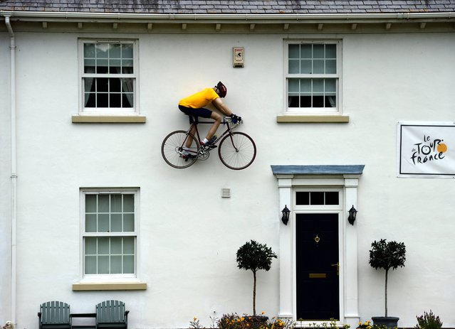 A model supporting the Tour de France on a house in the village of North Stainley which the riders will pass on Stage 1 between Leeds and Harrogate on July 3, 2014. (Photo by John Giles/PA Wire)