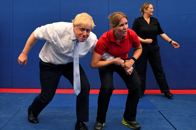 Boris Johnson, a leadership candidate for Britain's Conservative Party, reacts as he visits the Thames Valley Police Training Centre in Reading, Britain, July 3, 2019. (Photo by Dylan Martinez/Reuters/Pool)