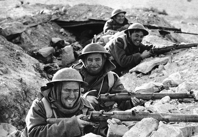 British Infantrymen in position in a shallow trench near Bardia, a Libyan Port, which had been occupied by Italian forces, and fell to the Allies on January 5, 1941, after a 20-day siege