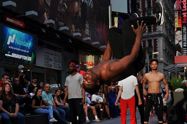 A break dancer does a flip in Times Square in the Manhattan borough of New York City, New York, U.S. June 1, 2017. (Photo by Carlo Allegri/Reuters)