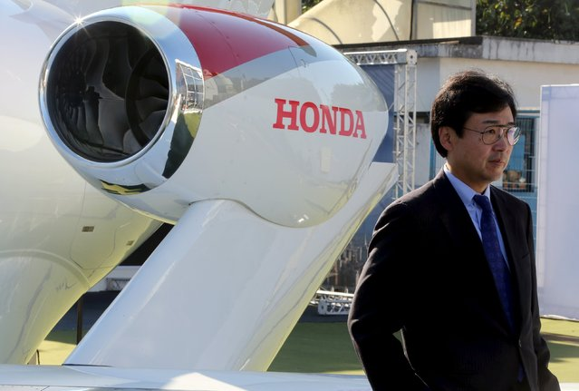 Honda Aircraft Company's President and Chief Executive Officer Michimasa Fujino poses for pictures with a Honda Aircraft Company's Honda jet in Sao Paulo, Brazil, August 10, 2015. (Photo by Paulo Whitaker/Reuters)