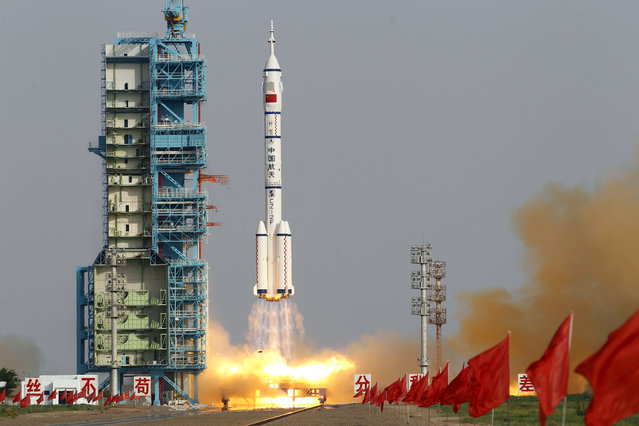 Shenzhou 9 spacecraft rocket launches from the Jiuquan Satellite Launch Center in Jiuquan, China, Saturday, June 16, 2012