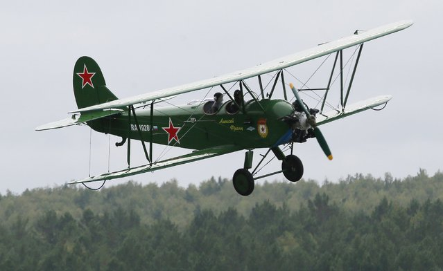 A Soviet-made Polikarpov Po-2 biplane flies during an air show to mark the Day of Air Fleet of Russia at the Yemelyanovo International Airport outside the Siberian city of Krasnoyarsk, Russia, August 15, 2015. (Photo by Ilya Naymushin/Reuters)