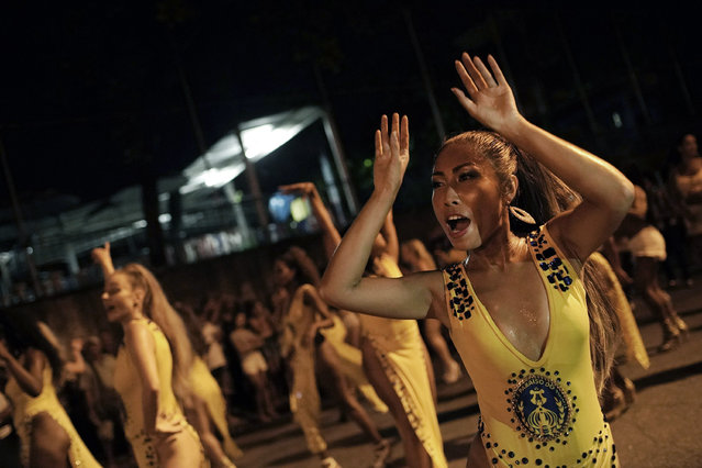 In this January 27, 2020 photo, Rie Tankana dances during a rehearsal of the Paraiso de Tuiuti samba school in Rio de Janeiro, Brazil. Tankana, from Osaka, Japan, performs at the annual Carnival celebration in Tokyo. She first found Paraiso de Tuiuti School on Instagram last year and is participating for the first time this year. (Photo by Silvia Izquierdo/AP Photo)
