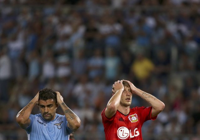Lazio's Mauricio and Bayer Leverkusen's Stefan Kiessling (R) react during their Champions League play-off soccer match at the Olympic stadium in Rome, Italy August 18, 2015. (Photo by Alessandra Bianchi/Reuters)