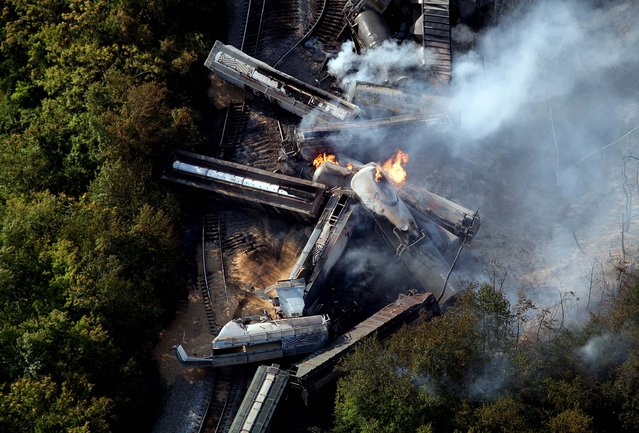 A derailed freight train burns in Columbus, Ohio on July 11, 2012
