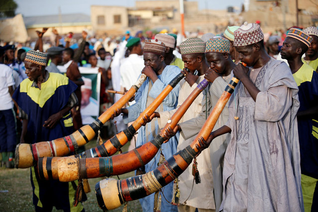 Traditional trumpeters perform during the durbar festival on the second day of Eid-al-Fitr celebrations in Nigeria's northern city of Kano, July 7, 2016. (Photo by Akintunde Akinleye/Reuters)
