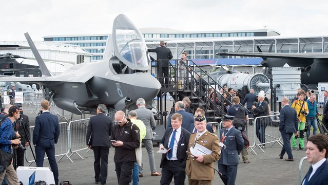 Visitors to the Farnborough Airshow in England inspect a full size model of the engine used to power the F-35 Lightning II aircraft. The Pratt & Whitney F135 propulsion system is the most powerful engine ever fielded, offering more than 40,000 pounds of thrust. (Photo by Fiona Hanson/AP Images for Pratt & Whitney)