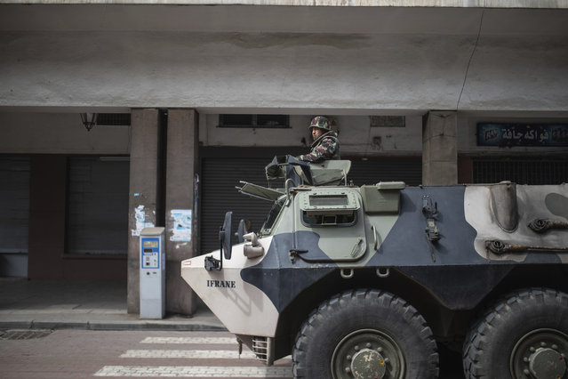 A military vehicle patrols the streets to enforce a health state of emergency and home confinement orders, in Rabat, Morocco, Sunday, March 22, 2020. (Photo by Mosa'ab Elshamy/AP Photo)