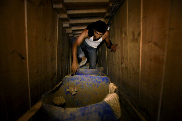 In this Monday, September 30, 2013 photo, a Palestinian works in a tunnel in Rafah, on the border between Egypt and the southern Gaza Strip. (Photo by Hatem Moussa/AP Photo)