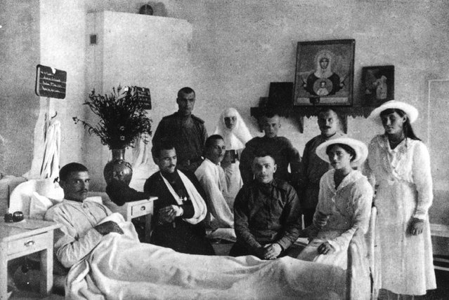 Grand Duchess Marie Nikolaievna (1899–1918) (right), and her sister Grand Duchess Anastasia Nikolaievna (1901–1918), two of the daughters of the Emperor Nicholas II, visit patients in the hospital on their estate, circa 1915.