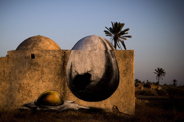 """A mural by Belgian artist ROA decorates a wall in the surrounding area of the village of Erriadh, on the Tunisian island of Djerba, on August 6, 2014, as part of the artistic project """"Djerbahood"""". (Photo by Joel Saget/AFP Photo)"""