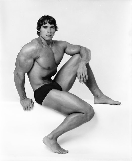 Professional bodybuilder Arnold Schwarzenegger posing at the top of his form in October 1976. (Photo by Jack Mitchell/Getty Images)