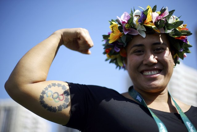 Weightlifter Luisa Peters (COK) of Cook Islands shows off a tattoo of the Olympic rings during the welcoming ceremony for the country's contingent in Rio de Janeiro, Brazil on August 4, 2016. (Photo by Ivan Alvarado/Reuters)