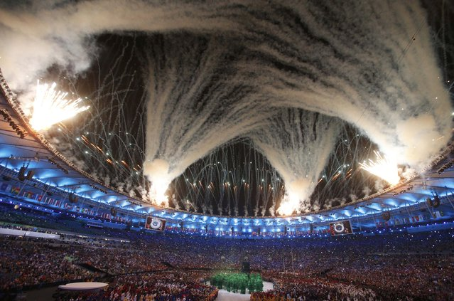2016 Rio Olympics, Opening ceremony, Maracana, Rio de Janeiro, Brazil on August 5, 2016. Fireworks explode during the opening ceremony. (Photo by Stoyan Nenov/Reuters)
