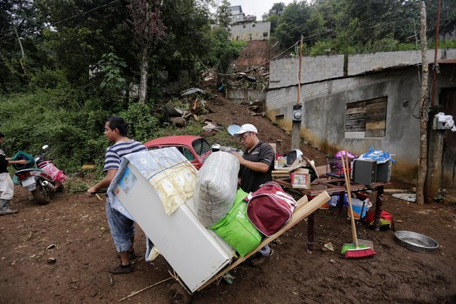 Residents recover belongings from their house, which was damaged by a mudslide, in the aftermath of Tropical Storm Earl in the town of Huauchinango, in Puebla state, Mexico, August 8, 2016. (Photo by Imelda Medina/Reuters)