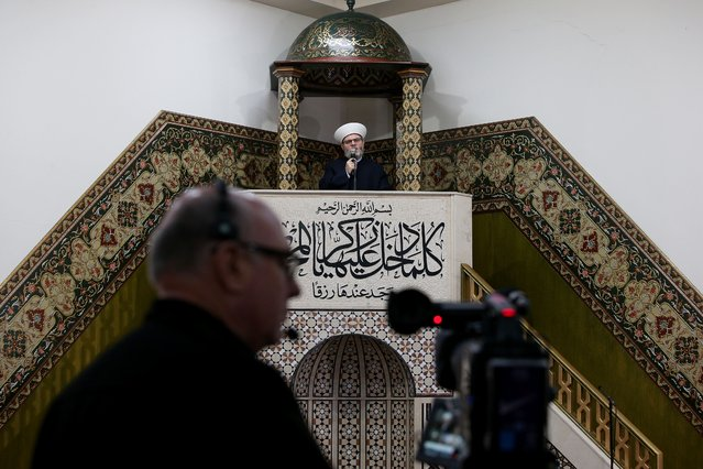 Sheikh Yahya Safi, Imam of Lakemba Mosque delivers an Eid al-Fitr sermon during a live online prayer event on May 24, 2020 in Sydney, Australia. Lakemba Mosque usually hosts up to 40,000 community members during Eid al-Fitr, due to COVID-19 restrictions they have remained closed, alternatively offering a live online 'Eid Prayer and Sermon Program' for those at home who wish to remain connected. Muslim communities across Australia are finding ways to celebrate Eid al-Fitr, many marking the end of Ramadan in small groups at their homes due to the COVID-19 restrictions. Some mosques remain closed offering online streaming while others are providing limited access. (Photo by Lisa Maree Williams/Getty Images)