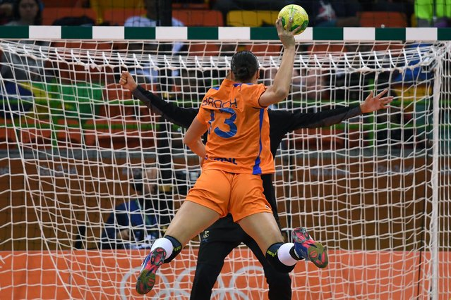 Netherlands' pivot Yvette Broch takes a 7-metre shoot out during the women's preliminaries Group B handball match Sweden vs Netherlands for the Rio 2016 Olympics Games at the Future Arena in Rio on August 12, 2016. (Photo by Roberto Schmidt/AFP Photo)