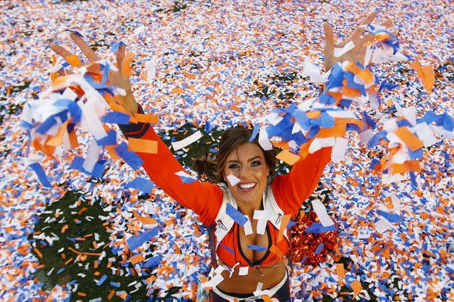 A Denver Broncos cheerleader celebrates after they defeated the New England Patriots 26 to 16 during the AFC Championship game at Sports Authority Field at Mile High on January 19, 2014 in Denver, Colorado. (Photo by Doug Pensinger/Getty Images)