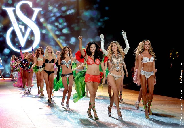 Adriana Lima, Doutzen Kroes and Candice Swanepoel lead the final runway walk during the 2012 Victoria's Secret Fashion Show. (Photo by Charles Sykes/Evan Agostini)