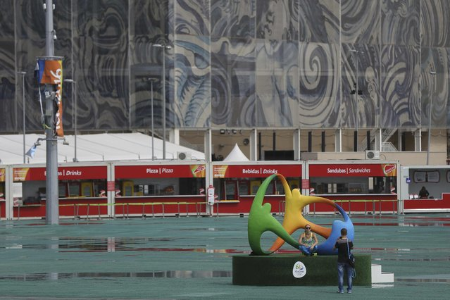 A couple take a photo in the Olympic Park a day after the closing ceremony of the Rio 2016 Olympic Games, in Rio de Janeiro August 22, 2016. (Photo by Bruno Kelly/Reuters)