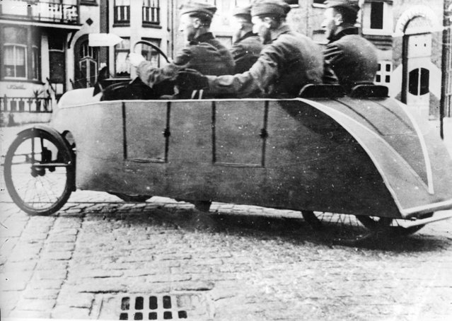 To save petrol German soldiers use a pedal car to get around in towns. 28th January 1941. (Photo by Keystone)