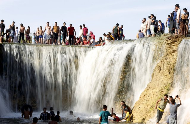 Egyptians enjoy at a waterfall in Wadi El-Rayan, near the end of the summer vacation at the desert of Al Fayoum Governorate, southwest of Cairo, Egypt, September 29, 2015. The new academic year began for most Egyptian students on Monday after the Eid al-Adha festival, while university students will commence theirs on October 4, state news agency MENA reported. (Photo by Amr Abdallah Dalsh/Reuters)