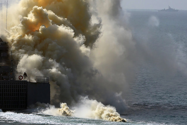 Russia's navy ships take part in a military exercise called Kavkaz (the Caucasus) 2016 at the coast of the Black Sea in Crimea on September 9, 2016. The country is staging war games on land, air and sea in manoeuvres across Russia's entire southern military district on the border of Ukraine. Russia annexed the Crimean peninsula from Ukraine in April 2014 and since then has sent thousands of troops and heavy weaponry there. Today it flexed its muscles by inviting media and international military officials to watch as thousands of soldiers performed tank battles and amphibious landings. Helicopter gunships and missile batteries repelled a mock invasion from the sea and the whole exercise involved more than 120,000 troops. (Photo by Vasily Maximov/AFP Photo)