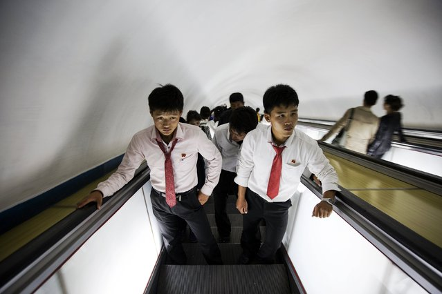 Students use escalators to exit a subway station visited by foreign reporters during a government organised tour in Pyongyang, North Korea, October 9, 2015. (Photo by Damir Sagolj/Reuters)