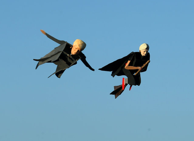 Remote control planes resembling U.S. Presidential candidate Donald Trump and Hillary Clinton fly over the beach in Carlsbad, California, U.S. September 15, 2016. (Photo by Mike Blake/Reuters)