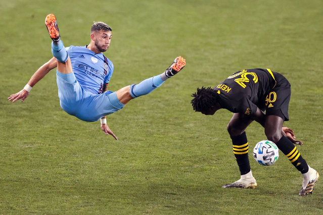 New York City FC midfielder Valentin Castellanos (11) falls after battling Columbus Crew defender Aboubacar Keita (30) for a high ball during the second half at Red Bull Arena in New York, August 24, 2020. (Photo by Vincent Carchietta/USA TODAY Sports)