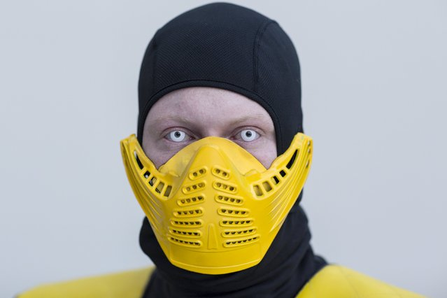 Charlie Cannon attends New York Comic Con dressed as Scorpion from Mortal Kombat in Manhattan, New York, October 8, 2015. (Photo by Andrew Kelly/Reuters)