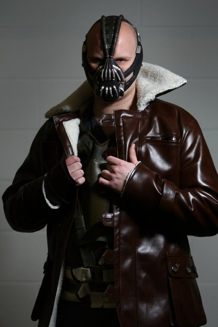 An actor dressed as Bane from the film Batman poses for a photo at the London Super Comic Convention at the ExCeL Centre on February 23, 2013 in London, England. Enthusiasts at the Comic Convention are encouraged to wear a costume of their favourite comic character and flock to the ExCeL to gather all the latest news in the world of comics, manga, anime, film, cosplay, games and cult fiction. (Photo by Jordan Mansfield)
