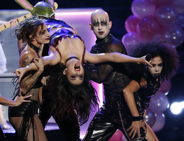 Charli XCX performs a medley of songs during the 42nd American Music Awards in Los Angeles. (Photo by Mario Anzuoni/Reuters)