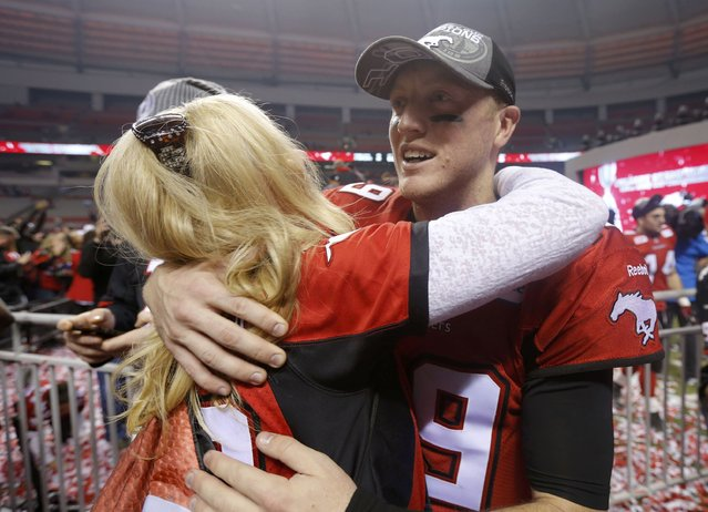 Calgary Stampeders' quarterback Bo Levi Mitchell hugs his mother Barbara after the Stampeders defeated the Hamilton Tiger Cats in the CFL's 102nd Grey Cup football championship in Vancouver, British Columbia, November 30, 2014. (Photo by Todd Korol/Reuters)