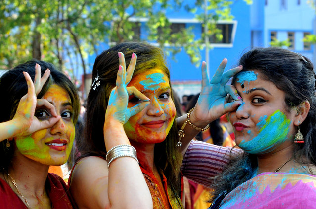 Student Rabindra Bharati University celebrates the Holi festival, Color Festival on February 26, 2018 in Kolkata, India. Holi, the popular Hindu spring festival of colours is observed in India at the end of the winter season on the last full moon of the lunar month, and will be celebrated on March 01 this year. (Photo by Debajyoti Chakraborty/NurPhoto via Getty Images)