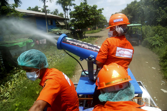 Members of the Shwe Yaung Mattar Foundation spray disinfectant along a street, in an effort to curb the spread of coronavirus, in Sittwe, Rakhine State, western Myanmar, 30 August 2020. (Photo by Nyunt Win/EPA/EFE/Rex Features/Shutterstock)