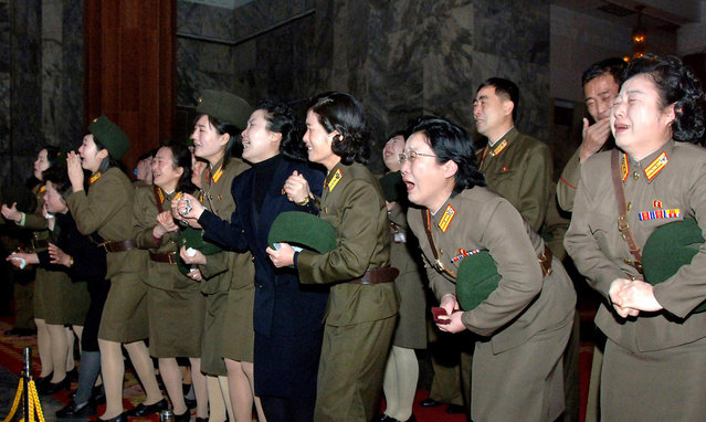 North Koreans weep for their deceased leader Kim Jong Il in Pyongyang, on December 23, 2011. (Photo by Reuters/KCNA)