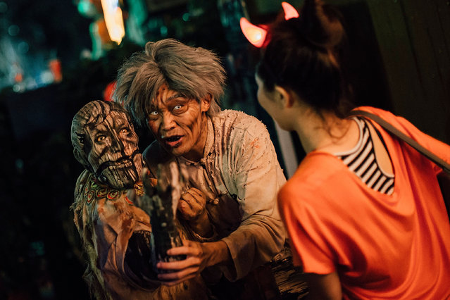 People attend a Halloween event at Ocean Park on October 30, 2015 in Hong Kong. Halloween - a named taken from 'All Hallows' Even' falls on the day before All Saints' Day on November 1 - a holiday when Christians remember their deceased loved ones. (Photo by Anthony Kwan/Getty Images)