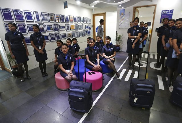 Prospective flight attendants listen to their instructor during a training session at Indigo Airlines' Ifly training centre in Gurgaon on the outskirts of New Delhi November 18, 2014. (Photo by Adnan Abidi/Reuters)
