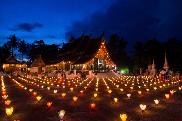 Lanterns are seen lit during the Wan Ok Phansa festival, marking the end of Buddhist lent, at Wat Xieng Thong temple in Luang Prabang, Laos on October 13, 2019. (Photo by Phoonsab Thevongsa/Reuters)