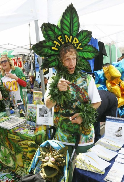 A man calling himself Henry Hemp works a vendor booth at the 4/20 marijuana holiday in Civic Center Park in downtown Denver April 20, 2013. (Photo by Rick Wilking/Reuters)