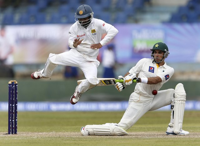 Sri Lanka's Kaushal Silva (L) jumps away from the ball as Pakistan's captain Misbah-ul-Haq plays a shot during the first day of their first test cricket match in Galle in this August 6, 2014 file photo. (Photo by Dinuka Liyanawatte/Reuters)