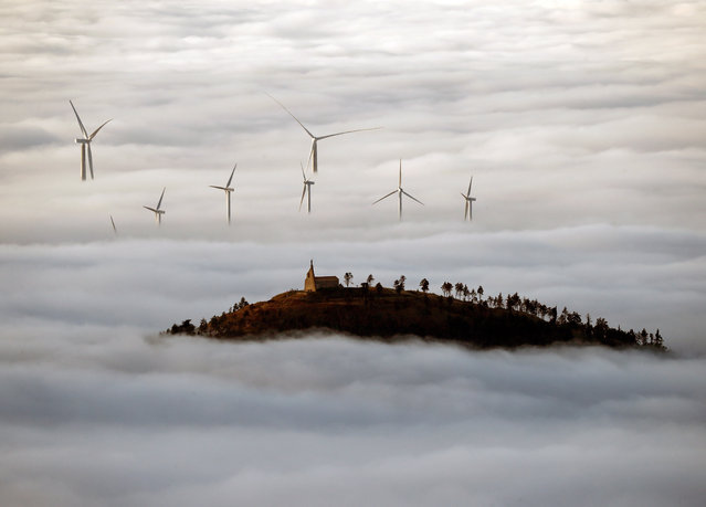 Fog covers a windmill field close to Pamplona, Navarra, northern of Spain, 12 November 2020. (Photo by Jesús Diges/EPA/EFE)