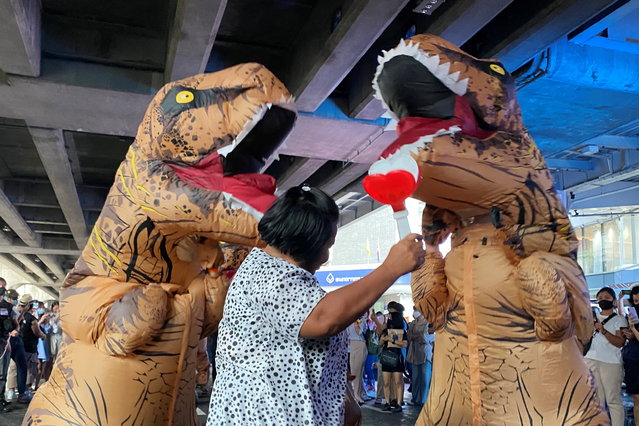 Dinosaur costumed actors representing Thailand's establishment at a high school student led protest in Bangkok, Thailand on November 21, 2020. (Photo by Matthew Tostevin/Reuters)